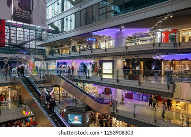 Parkview Green's shopping mall in Beijing with international brands from fast fashion to high-end luxury. Shopping mall with visitors during Christmas period. Beijing, China 2018/1