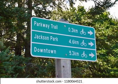 Parkway trail, Jackson park and downtown distance signs on the trail in Peterborough, Canada