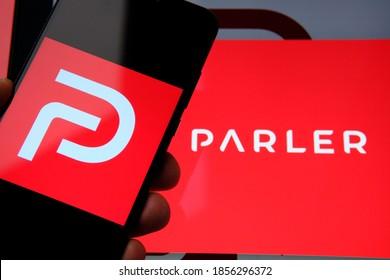 """Parler app"" logo seen on the screen of smartphone and on the blurred background. Parler is a Twitter alternative platform. Platform motto: Read News, Speak Free. Stafford, UK - November 10 2020."