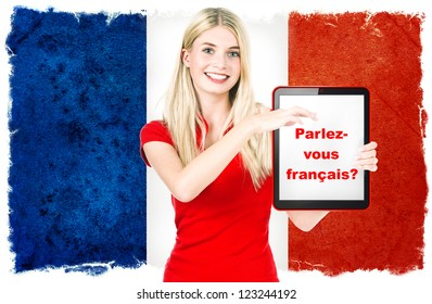 Parlez-vous francais? young woman holding tablet pc on the background with french national flag. french language learning concept