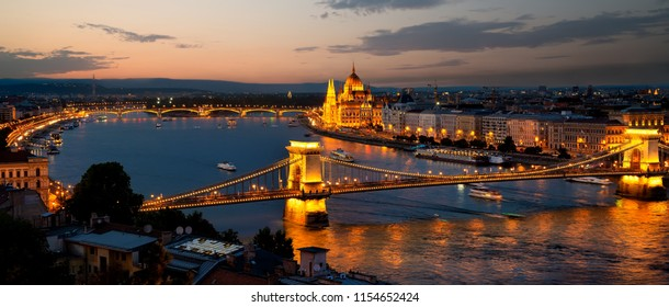 Parliament and bridges of Budapest illuminated in evening, Hungary