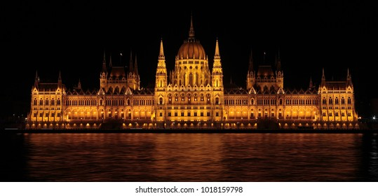 The Parliament of Budapest by night, view from Danube river, Hungary, Europe