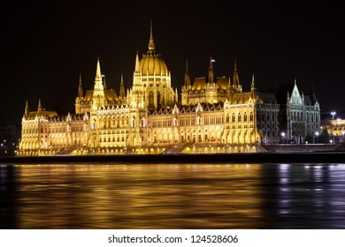 Parliament Building in Budapest, Hungary.  The Danube River is in the foreground.