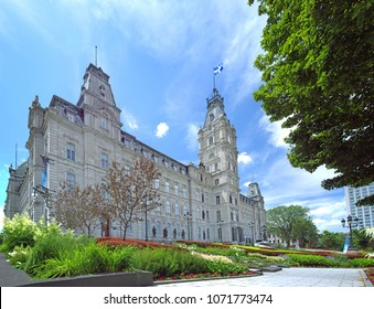 Parliament Building of Quebec province, Canada. July 5, 2011. National Assembly of Quebec and national flag of Quebec. View of Quebec parliament building during spring or summer season.