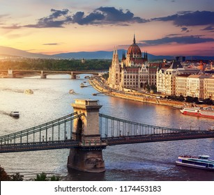Parliament and famous bridges of Budapest at sunset, Hungary