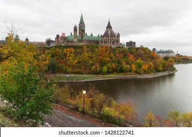 Parliament hill (Ottawa, Ontario, Canada). Beautifil wide-angle shot during the fall season. Crown land on the southern banks of the Ottawa River, downtown. Gothic revival style. Cloudy day.