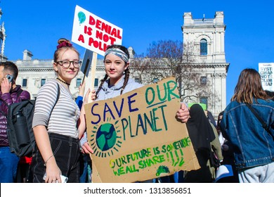 Parliament Square, London - February 15th 2019: YouthStrike4Climate, Students gather outside the houses of parliament in demonstration to fight against climate change.