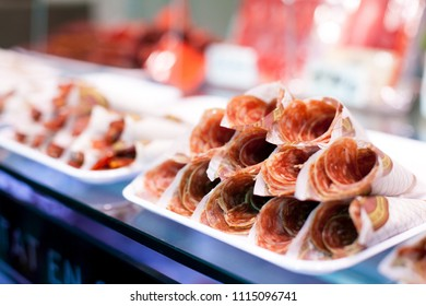 Parma ham or Hamon on display for sale at the Boqueria market in Barcelona
