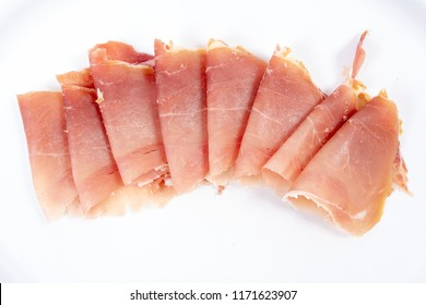 Parma ham, prosciuotto sliced for antipasto, food.