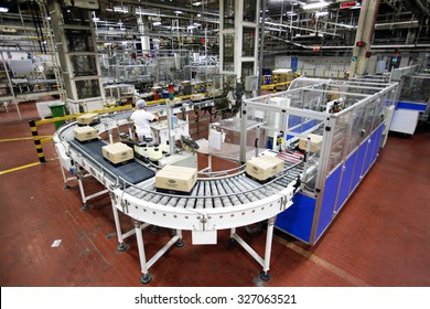 PARMA, ITALY - 3 OCTOBER 2012: Boxes of packaged pasta travelling along the production line inside a pasta factory.