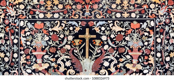 PARMA, ITALY - APRIL 15, 2018: The stone floral mosaic (Pietra Dura) with the cross on the side altar in church  Chiesa di Santa Cristina