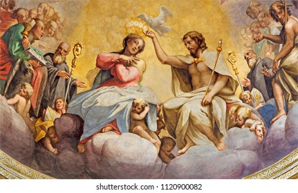 PARMA, ITALY - APRIL 15, 2018: The fresco of Coronation of Virgin Mary in main apse of church Chiesa di San Giovanni Evangelista by Cesare Aretusi (1587).