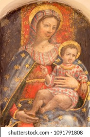 PARMA, ITALY - APRIL 16, 2018:  The fresco of Madonna with the child in church Chiesa di San Benetetto by unknown artist of 16. cent.
