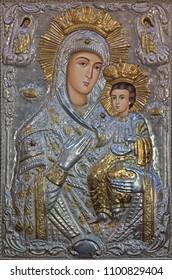 PARMA, ITALY - APRIL 16, 2018: The metalic icon of Madonna in church Chiesa di Santa Maria del Quartiere by unknown artist.