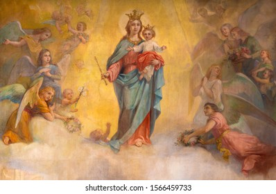 PARMA, ITALY - APRIL 16, 2018:  The painting of Madonna (Mary Help of Christians) among the angels in church Chiesa di San Benetetto from 20. cent.