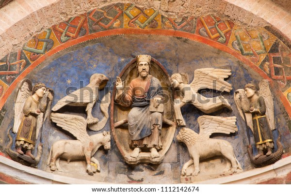PARMA, ITALY - APRIL 16, 2018: The relief of Jesus Christ the Pantokrator and symbols of the four Evangelists in Baptistery from 14 - 15. cent.