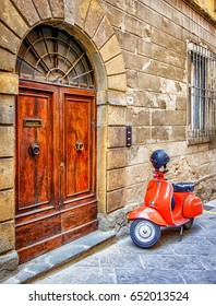 PARMA, ITALY - AUGUST 21: typical Vespa small motorbike at the old street on August 21, 2014 in Parma, Italy