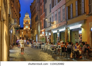 PARMA, ITALY - AUGUST 9: Street scene in Parma, Italy featuring the Palazzo del Guvernatore (Guvernor's Palace) at twilight on August 9, 2017.