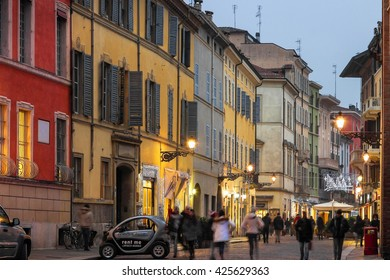 PARMA, ITALY - JANUARY 04, 2016: Old street with colorful buildings in historical part of Parma town, Emilia Romagna, Italy.