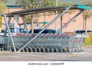 Parma, Italy - May 2016: empty shopping carts stacked together in a parking lot