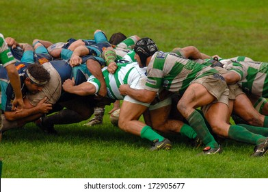 PARMA, ITALY - OCTOBER 12: Rugby players pushing in a scrum during the Italian Rugby League match Parma vs Treviso, in Parma, October 12, 2005.