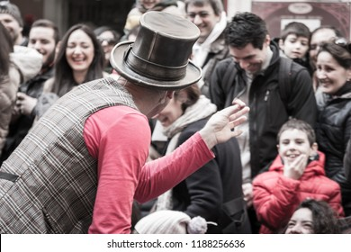 Parma, Italy - october 2015: illusionist with magician's hat during street performance, rear view