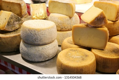 Parmesan and caciotta cheese and other aged cheeses for sale in the dairy