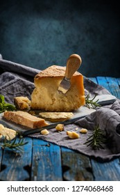 Parmesan cheese composition on blue background
