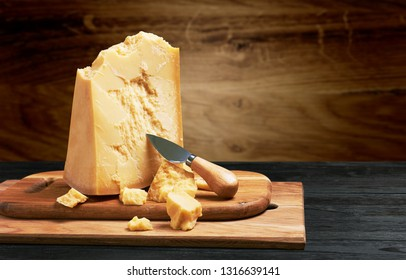 Parmesan cheese on wooden board