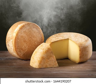 Parmesan cheese wheel on wood background