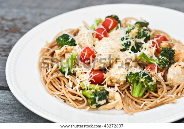 Parmesan Chicken and Broccoli served over whole wheat pasta