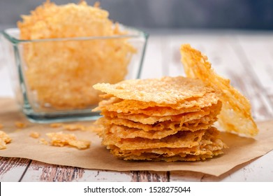 Parmesan chips. Appetizer for a gluten-free and ketogenic diet. Close up and horizontal orientation.