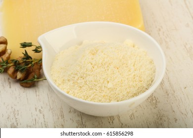 Parmesan grated cheese heap with walnuts and thyme