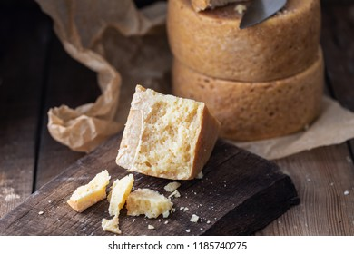 Parmesan and Pont-l'Eveque cheese cheeses on old wooden table