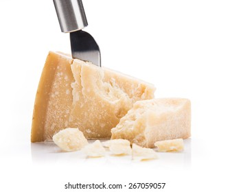 Parmigiano reggiano on white background, close-up.