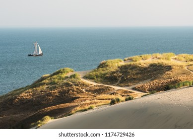 Parnidis dune and old wooden ship in Curonian lagoon. Curonian spit, Nida, Lithuania.