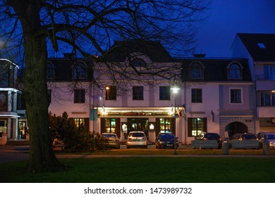 PARNU, ESTONIA - MAY 02, 2015: Night view Sweet Rosie irish pub on the Munga street in historical center of Parnu.