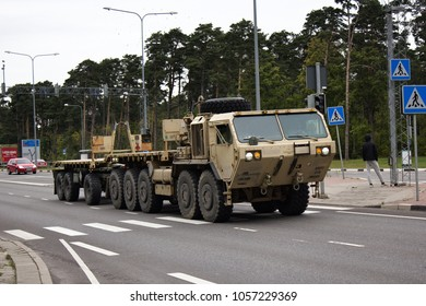Parnu, Estonia - September 4, 2017: Army equipment (military machinery, army transport) on highway. Tractor old model, rocket tractor, Soviet army, army transportation unit