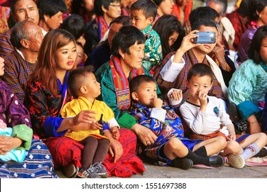 Paro, Bhutan - Apr 07, 2017: Spectators at the Paro Tshechu, at the Rinpung Dzong (a Buddhist monastery), the most popular religious dance festival in Bhutan held annually since the 17th century.