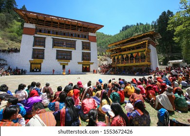 Paro, Bhutan - Apr 08, 2017: Spectators at the Paro Tshechu, at the Rinpung Dzong (a Buddhist monastery), the most popular religious dance festival in Bhutan held annually since the 17th century.