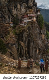 Paro, Bhutan - April 3, 2018 : Taktsang monastery (or Tiger's nest) photographed by a tourist at the final viewpoint