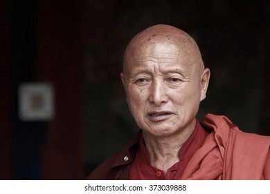 PARO, BHUTAN - CIRCA AUGUST 2014.  A solitary monk at Kyichu Lhakhang, the oldest temple in Paro, Bhutan
