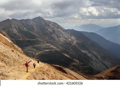 PARO, BHUTAN - circa October 2012: hikers in the mountains of Bhutan