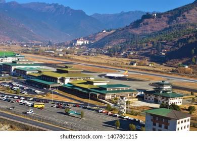 Paro, Bhutan- December 8,2018: Paro Airport in the Mountains - Bhutan. mountain landscape with village and mini airport