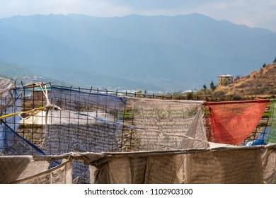 Paro, Bhutan - March 28, 2018 : The prayer flags of Dungtse temple with in the background the Himalaya mountains