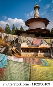 Paro, Bhutan - March 28, 2018 : Dungtse temple behind the many prayer flags. Dungtse temple was founded in 1421 by Drubthop Thangthong Gylepo.