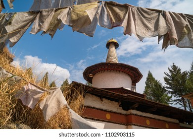 Paro, Bhutan - March 28, 2018 : The old Dungtse temple behind prayer flags