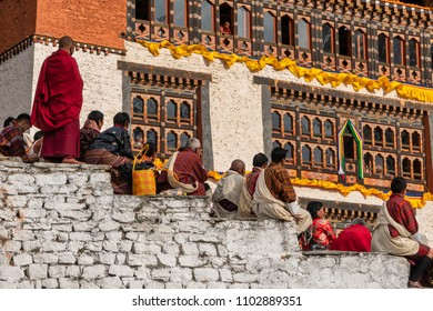 Paro, Bhutan - March 29, 2018 : Spectators sitting on the stone made tribune watching the annual Paro festival