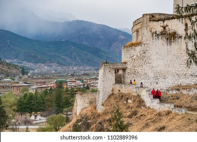 Paro, Bhutan - March 29, 2018 : Monks walking at the outskirts of the Paro Dzong
