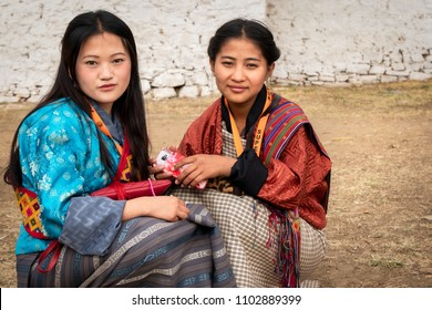 Paro, Bhutan - March 29, 2018 : Girls in traditional dress visiting the annual Part festival